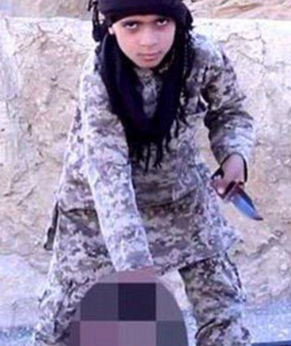 ISIS child stands and holds knife to man's throat