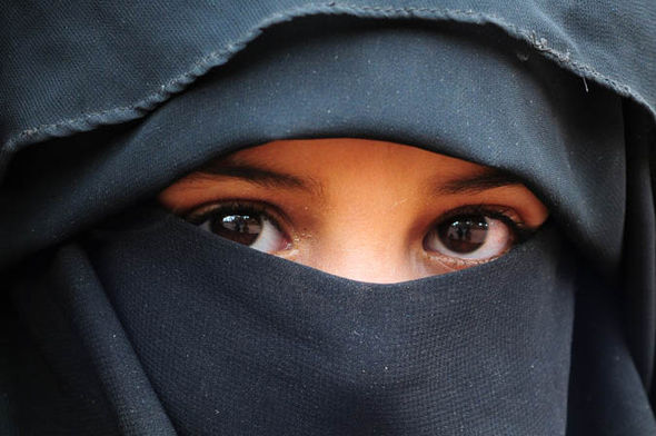 A child in a burka