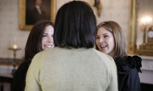 Michelle Obama talks to George W Bush's daughters