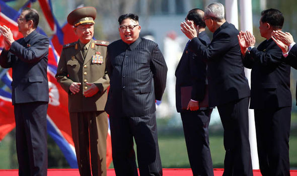 Kim Jong Un smiles on the podium