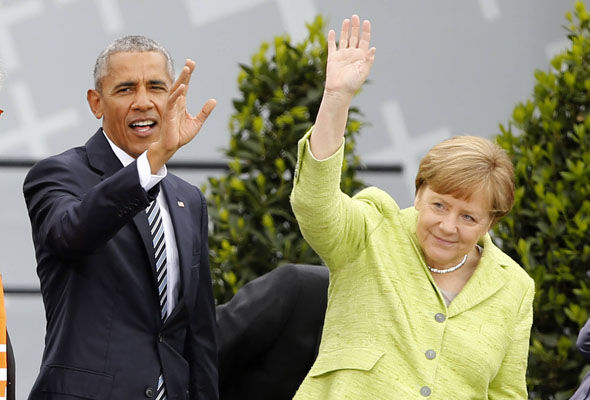 A smiling Mr Obama and Mrs Merkel waved to the crowds