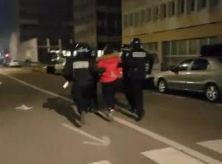 Police appear to arrest a man