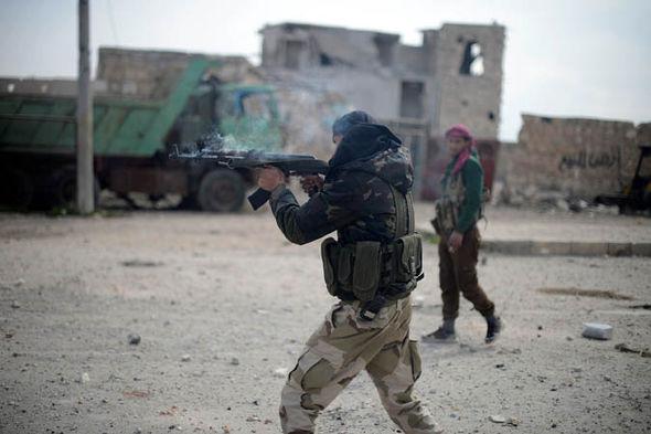 Syrian rebel firing his rifle
