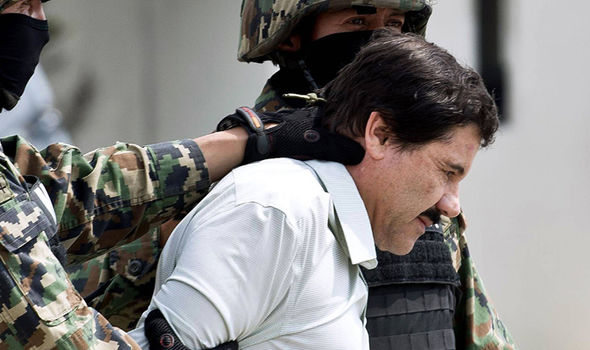 The Mexican drug lord is trasnported by armed officials following two successful jailbreaks