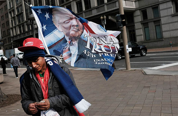 Boy carrying Trump memorabilia