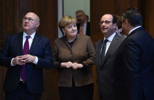 Mr Sapin has been having meetings with Merkel and Hollande