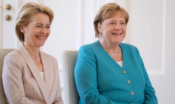 Ursula von der Leyen alongside Angela Merkel