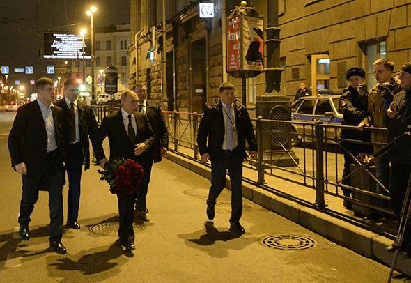 Vladimir Putin with roses