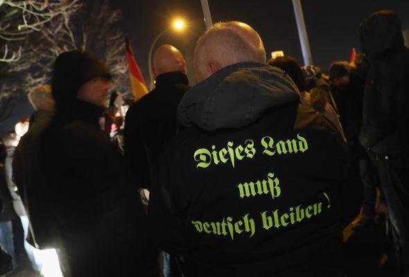 A man's jacket reads