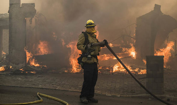 Fire crew at burnt out building in california