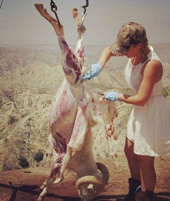 woman skinning animal