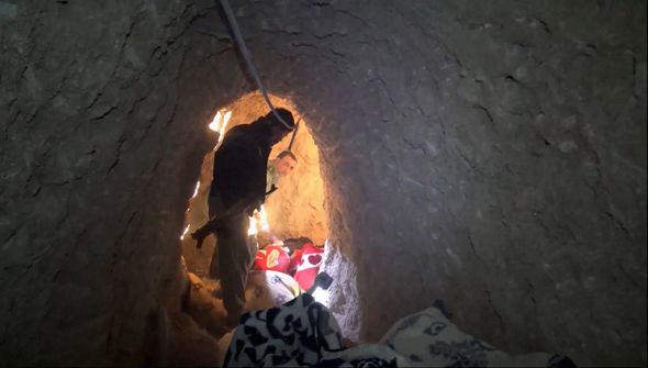 Kurdish security forces are seen in a tunnel complex under the city of Sinjar used by ISIS