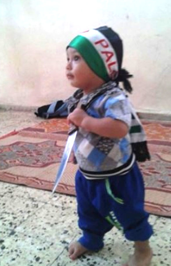 Boy holding knife and wearing flag scarf