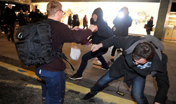 Two men in fight during rally