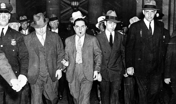 American Gangster Charles Lucky Luciano (2nd Right) being led from a New York court