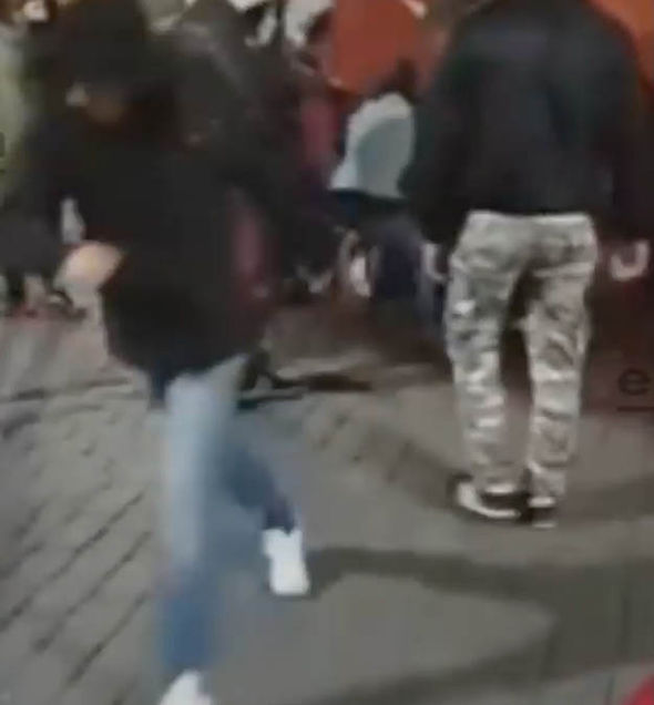 Gang attack woman outside bar