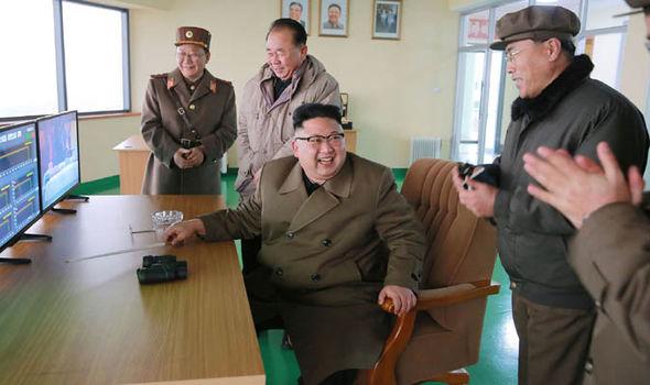 Kim Jong-Un celebrates missile test