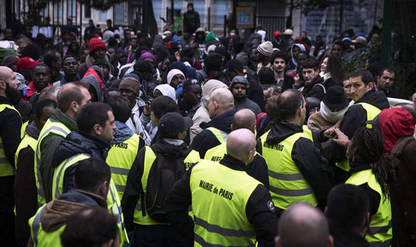 Migrants are confronted by police in Paris