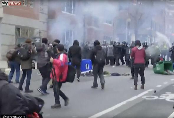 Stun grenades are used as riot police push protestors back in Washington DC
