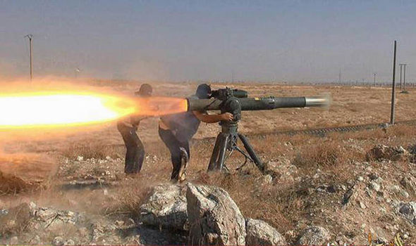 An ISIS fighter fires a rocket launcher