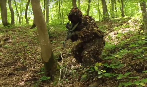 A Spetsnaz soldier in a 'Ghillie' suit in the forest