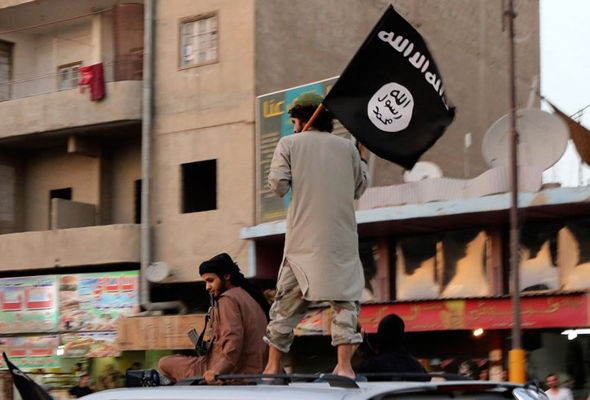 ISIS ffighters wave their flag