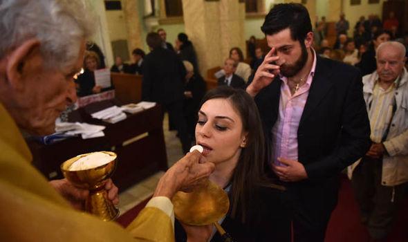 Turkish Christians receive communion