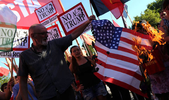 Protestors burn flags in the streets