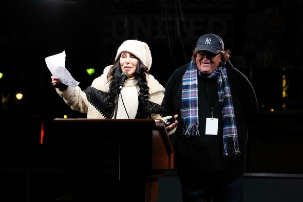Cher stood alongside Michael Moore