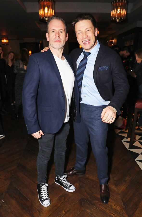 Chris Moyles stood proud next to Jamie Oliver