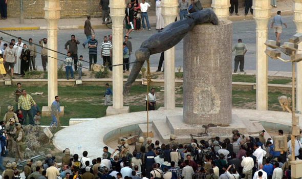 Saddam Hussein statue being destroyed