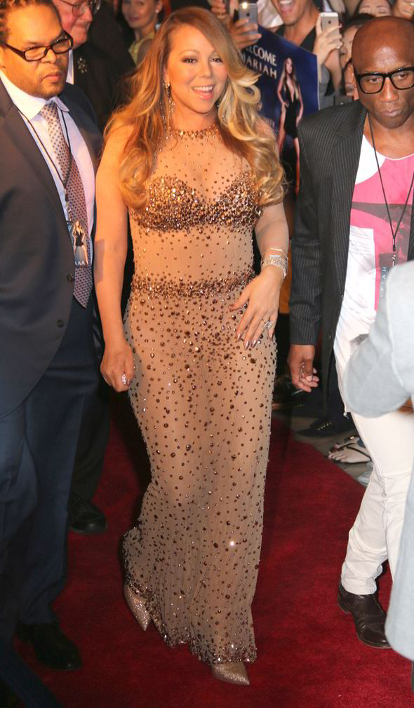 Mariah Carey Makes Dazzling Entrance In Sheer Gown As She