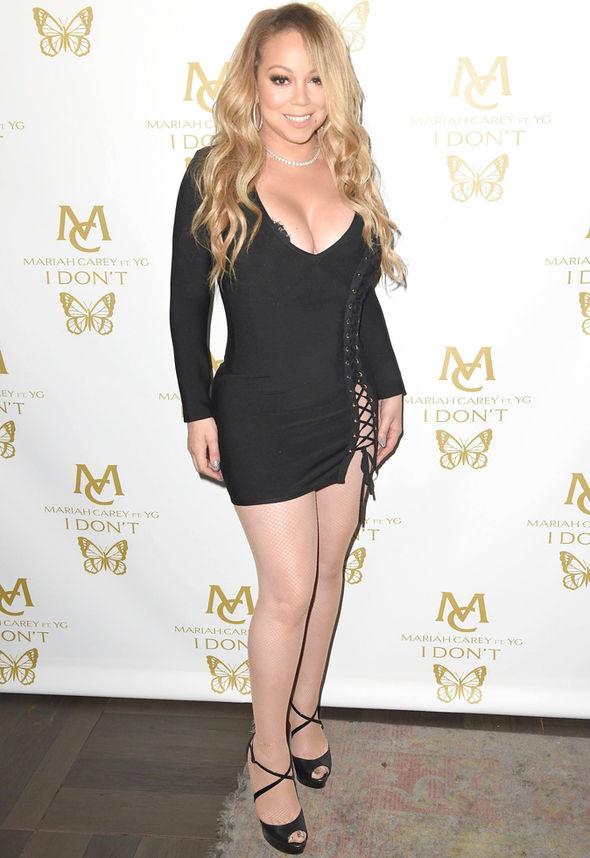 Mariah Carey boyfriend Bryan Tanaka cleavage wardrobe malfunction