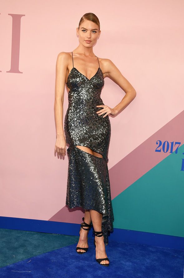 Martha Hunt opted for a similar revealing dress
