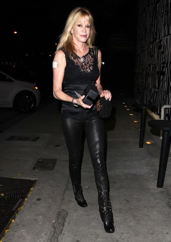 Melanie Griffith Sets Pulses Racing In Black Leather