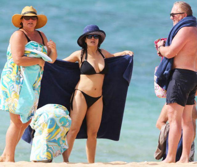 Salma Teamed Her Plunging Bikini With A Blue Sun Hat