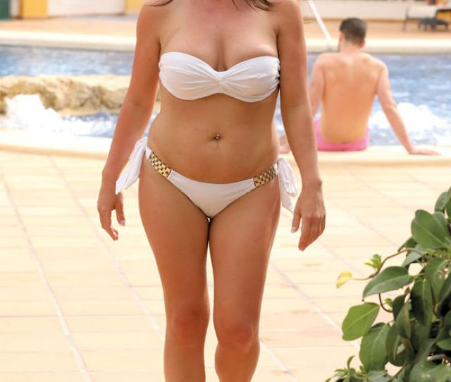 Karen Showed Off Her Curvaceous Figure In A Sexy White Bandeau Bikini