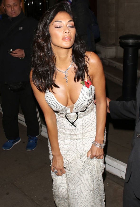 Nicole Scherzinger almost spilled out of her dress as she left the Pride of Britain Awards