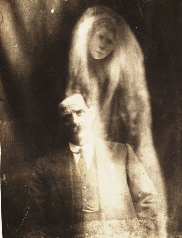 The 'spirit' of a man's wife appears in a 1923 picture taken in England by William Hope