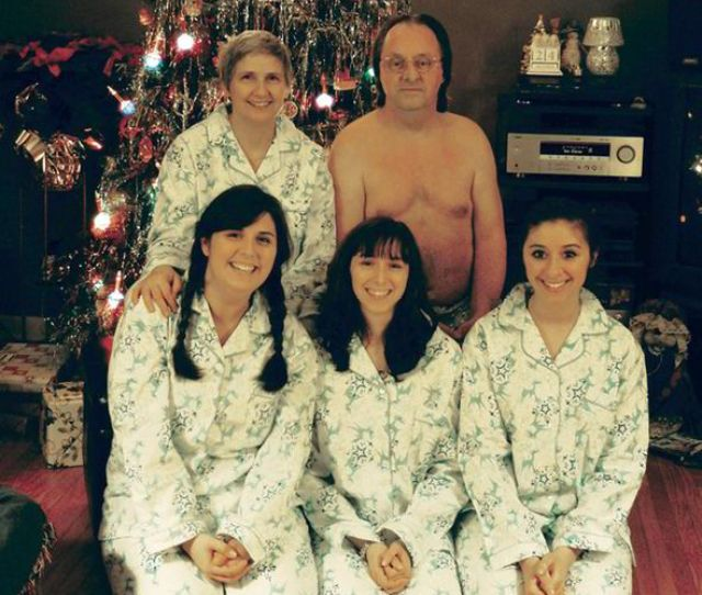 A Touching Family Photo By The Christmas Tree With A Balding Nude Man Crouched