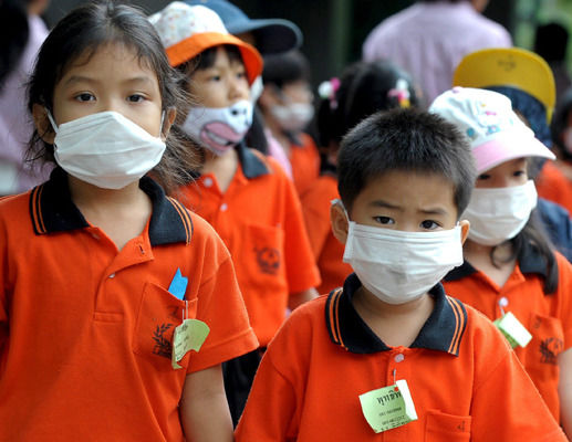 Thai pupils wear face masks during a visit to the Science Museum in Bangkok.