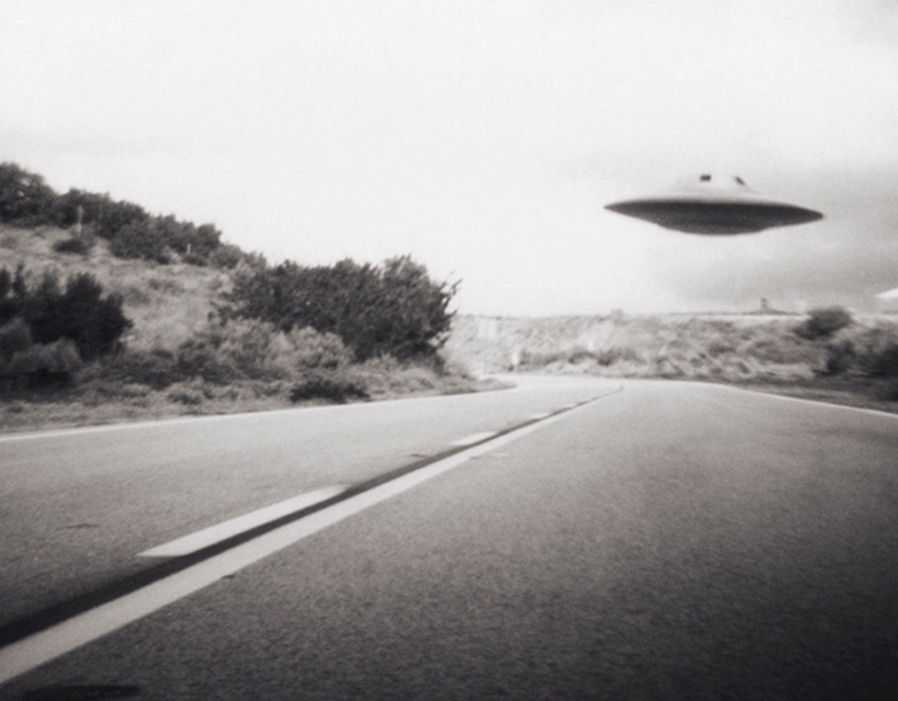 Flying saucer above highway, real or not?