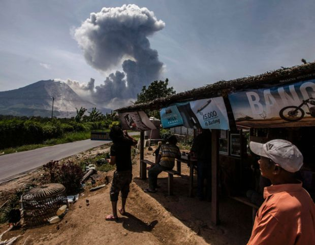 Indonesian residents look at the Mount S