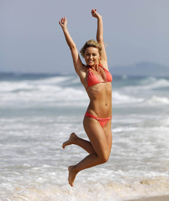 Ola Jordan jumps for joy as she prepares to enter the I'm a Celebrity jungle