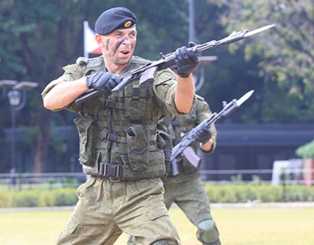 Russian Marines show their individual combat skills during a public capability demonstration at the Luneta National Park in Metro Manila