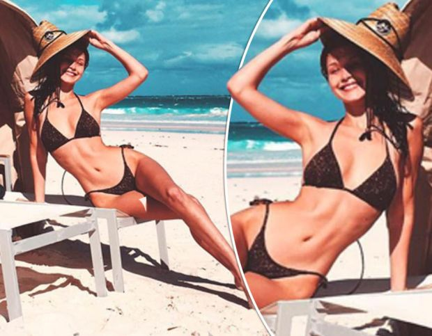 Bella Hadid looks smoking hot as she flaunts major cleavage and toned tummy in racy bikini