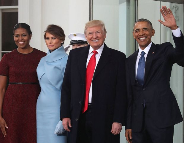 President-elect Donald Trump (2ndR),and his wife Melania Trump (2ndL), are greeted by President Barack Obama and his wife first lady Michelle Obama, upon arriving at the White House on January 20, 2017 in Washington, DC.