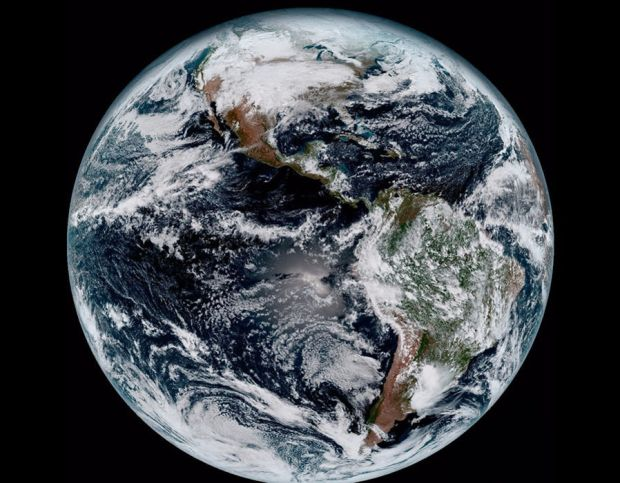 This composite color full-disk visible image of the Western Hemisphere was captured from NOAA GOES-16 satellite at 1:07 pm EST on Jan. 15, 2017 and created using several of the 16 spectral channels available on the satellite's sophisticated Advanced Baseline Imager. The image, taken from 22,300 miles above the surface, shows North and South America and the surrounding oceans.