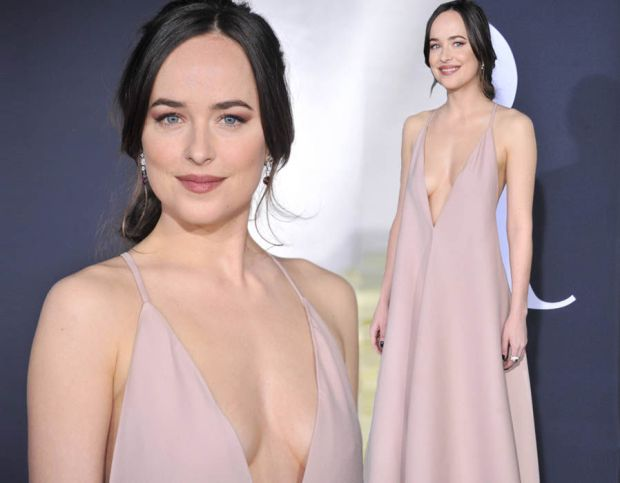 Dakota Johnson goes braless as she takes the plunge at Fifty Shades Darker premiere
