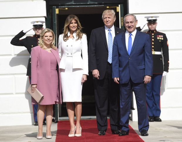 US President Donald Trump and First Lady Melania Trump welcome Israeli Prime Minister Benjamin Netanyahu and his wife, Sara, as they arrive at the White House in Washington